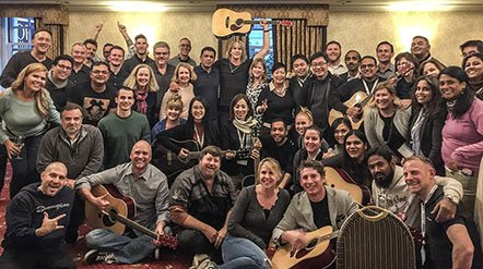 Group Guitar-and-Sip Class for Team-Building